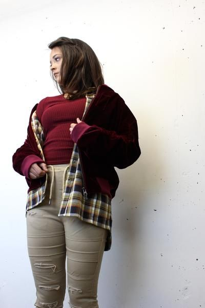 Maroon Velvet bomber jacket + long sleeve brown plaid flannel shirt + khaki ripped joggers + maroon knit sweater with choker