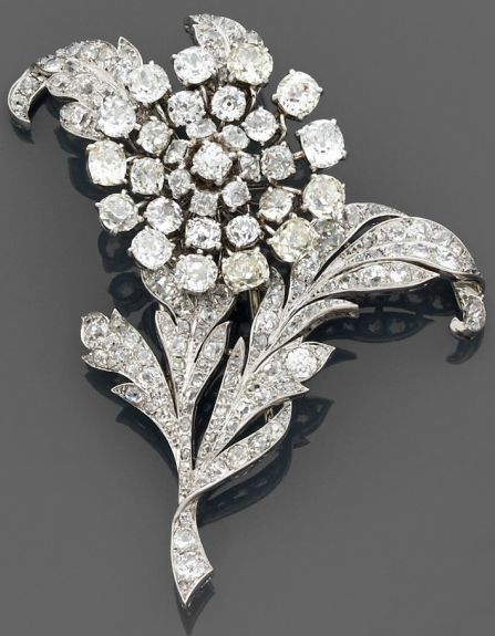 A diamond and platinum brooch by CHAUMET circa 1930. Designed as a flowering…