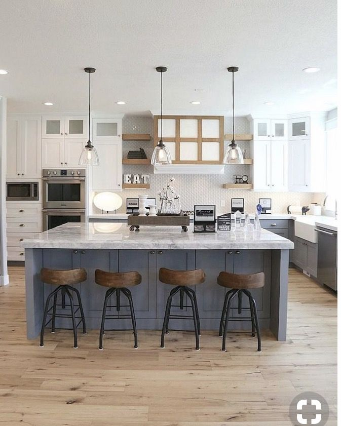 Dark blue island with gas cooktop and griddle, with grey ...