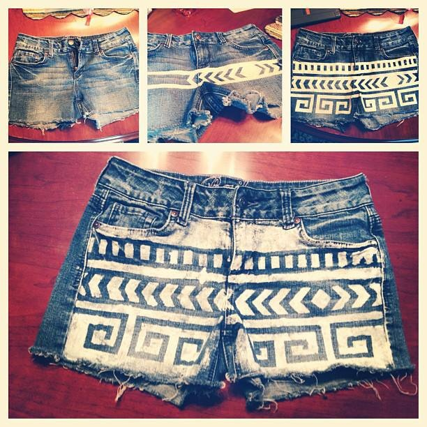 Cutoff shorts from old jeans, then make stencil out of masking tape and then apply fabric paint. Let dry, and peel off the tape! #DIY #shorts #jeans #summer #easy