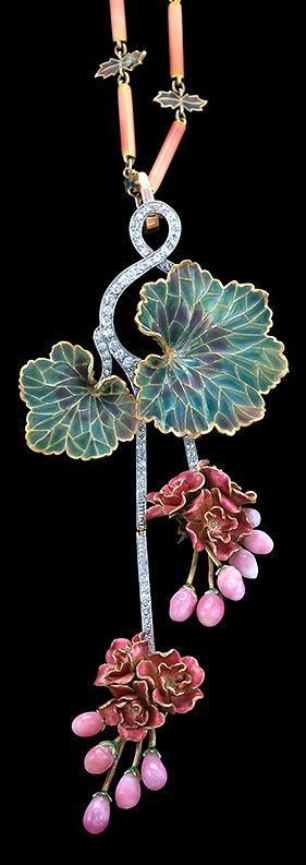 Circa 1900 An Art Nouveau 18 karat gold, diamond, conch pearl and plique-à-jour enamel 'Morning Glory' necklace, attributed to Marcus & Co., circa 1900. The pendant set with round diamond accents culminating in plique-à-jour flower clusters with 11 conch pearls, the detachable chain composed of shaded pink tubular links and green plique-à-jour leaf-form links. #Marcus #ArtNouveau #necklace