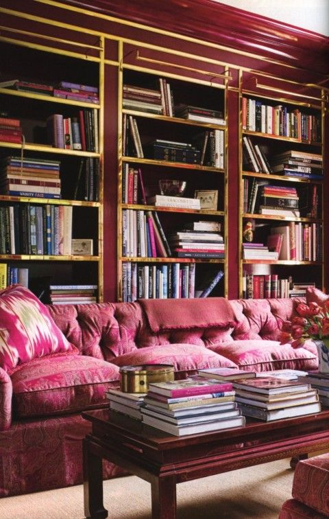 A Pink Library! Even the moulding and furniture has a pink tone.