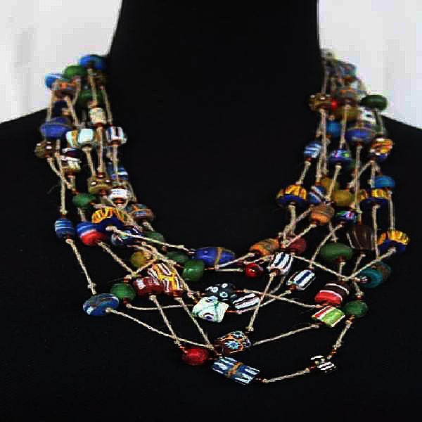 Check out this unique Vintage Ashino necklace from Inka of Ghana. A collection of vintage trade beads, Venetian, krobo recycled glass beads, bosom beads and chevron. Get yours online now at www.nuerasamp.com.