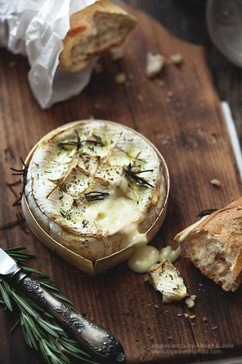 oven baked soft brie or goat cheeses with herbs, shallots and garlic - served with crusty french baguette