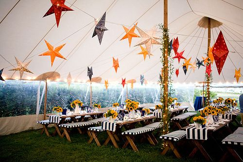 Love the sunflowers, stars and stripy table cloths! Great ways to brighten up a marquee wedding.