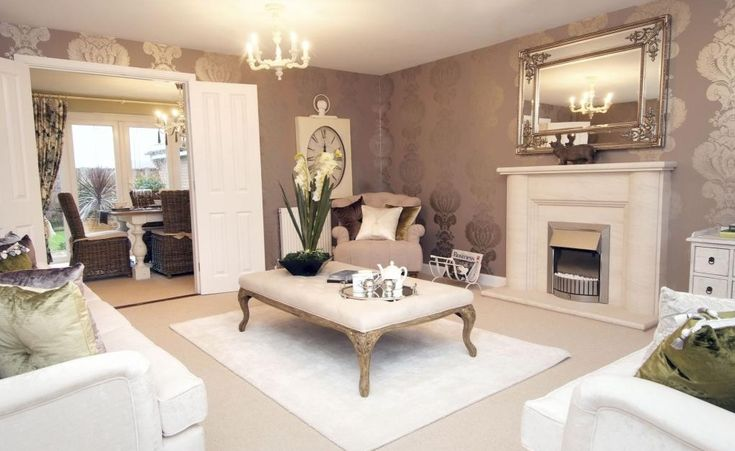 David Wilson Homes in Worcestershire.  Fabulous luxurious and elegant living room in a French style with foiled wallpaper in mauve - double doors opening up to a beautiful French dining room.  I love the watch / clock on the wall.