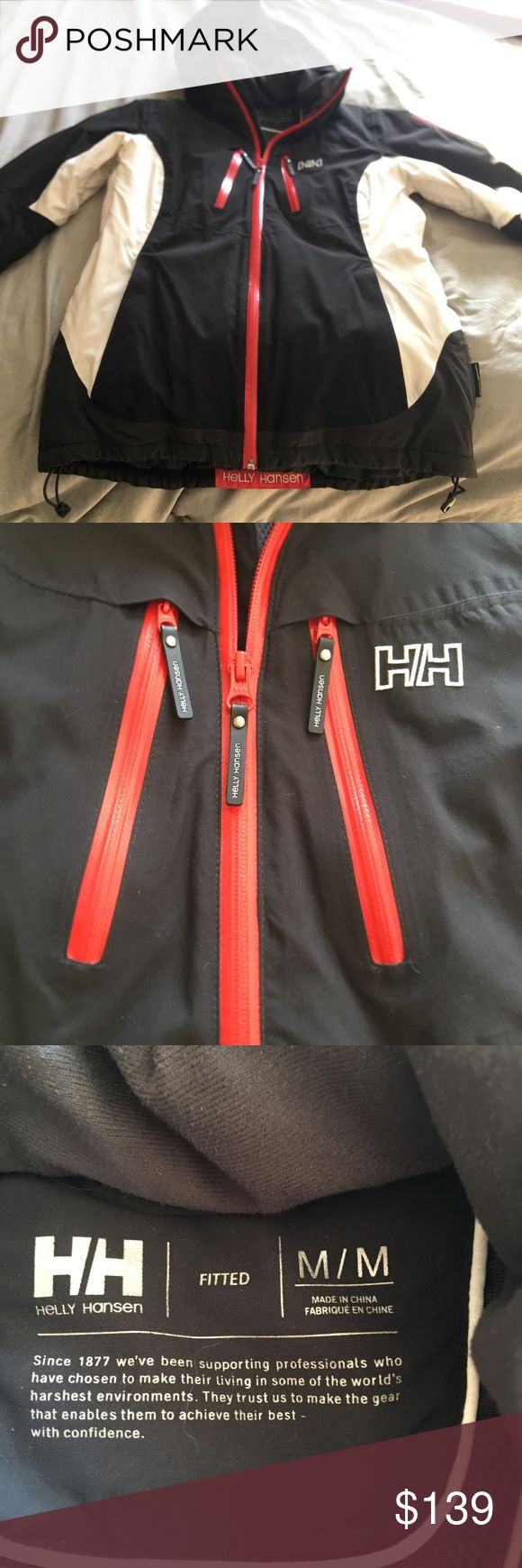 Helly Hansen Helly Tech Performance Ski Jacket Women's fitted Helly Hansen Jacket. Super warm ski jacket, black and white with red accents. In excellent shape. White part is slightly dirty from riding the lifts but definitely would come out if ran through the wash with some tech gear wash. Waterproof and breathable. Amazing quality Jacket. Helly Hansen Jackets & Coats