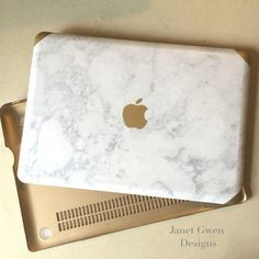 Hard gold case for Mac Book Pro 13 with marble detailing for the top and a resin top coat. Check out our other products ---->