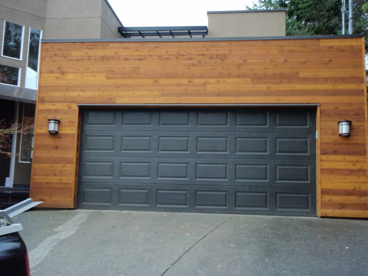 Best 25 shiplap siding ideas on pinterest farmhouse for Cedar wood garage doors price