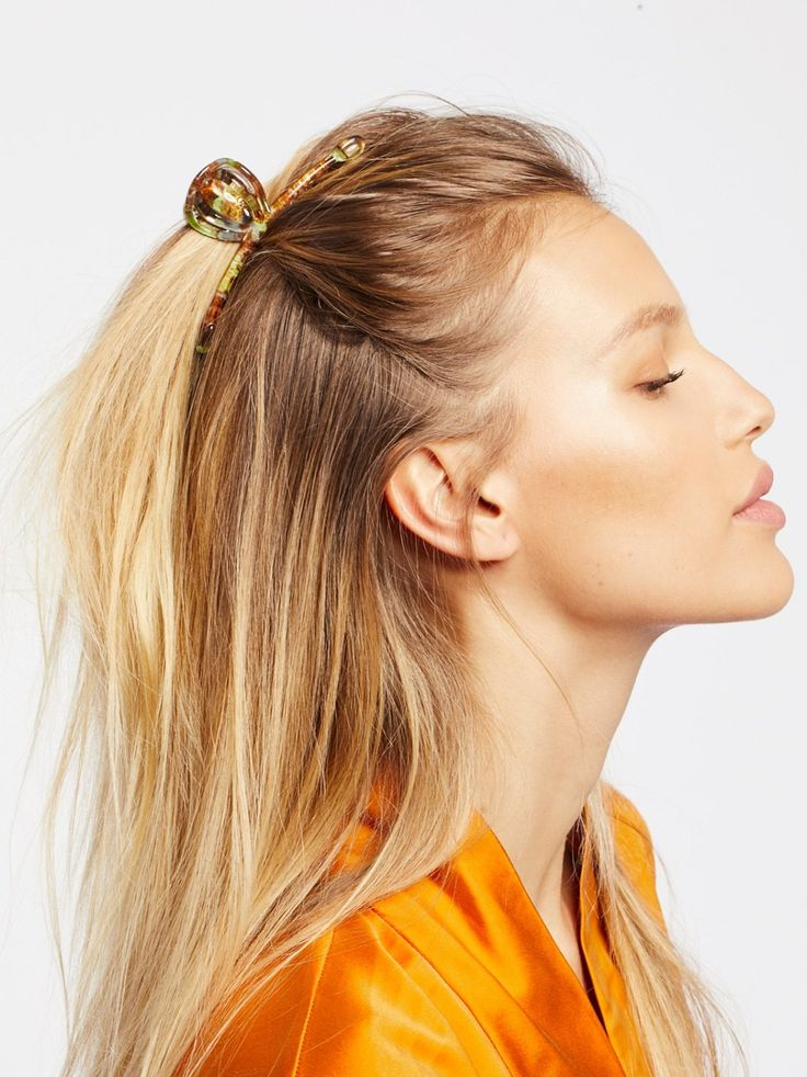 Fine Hair Claw | Made in France, this plastic hair claw features comb accents and elastic closure for a secure fit.