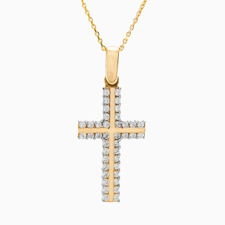 Stunning 14k yellow gold cross pendant is accented with glistening round cut crystals.
