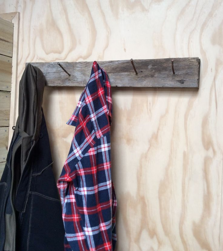 Coat hanger for hubby's man cave. Made from a piece of olf timber and some old 8inch nails which were from a old work bench that we took down.