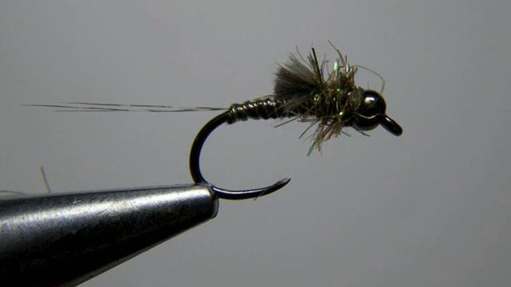 A spiced up version of a euro style bwo nymph utilizing some newer materials and hooks not readily available to those of us in the states.  The construction of this…