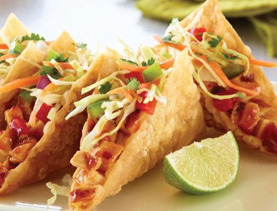 CHICKEN WONTON TACOS - Zesty grilled chicken stuffed in crispy wonton shells and topped with crunchy Asian slaw and cilantro.