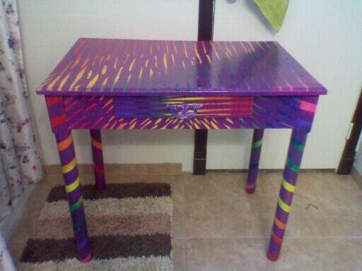 Awesome rainbow zebra print desk.