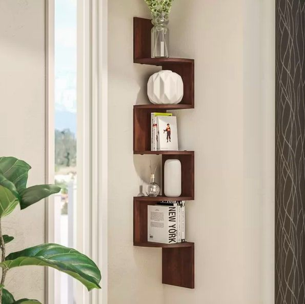 22 Pieces Of Decor To Make The Most Out Of Every Corner In Your Home Corner Wall Shelves Wall Shelves Corner Shelf Design