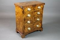 """A George I style burr walnut Bachelor's chest, cross banded, with hinged top above an arrangement of 2 long and 4 short drawers, raised on shaped bracket feet 30""""h x 25""""w x 14""""d SOLD £1100"""