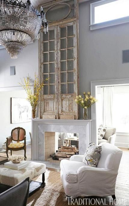 Classic Mantles - This is such a great room!  Love the open fireplace & I love those salvaged doors on the mantle!  What a great way to fill a space with high ceilings.