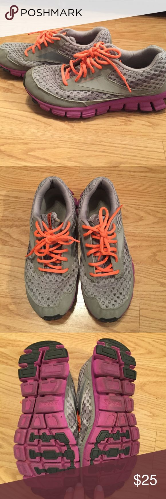 Reebok SmoothFlex Cushrun Running Shoe These gray running shoes with purple soles and neon orange laces are lightweight and in great shape! Awesome colors and a great fit! Reebok Shoes Sneakers