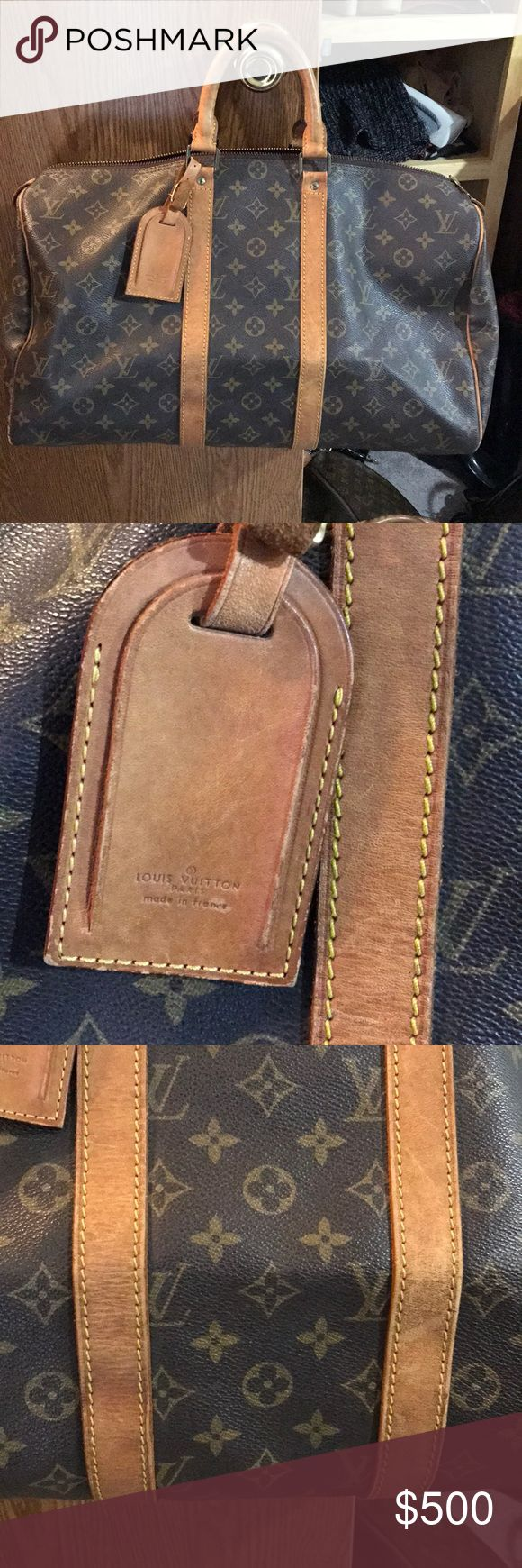 Louis Vuitton Keepall 45 Vintage Keepall 45, comes with dust bag, lock & key, luggage tag.  This is a used vintage bag. Please review all pictures.  Zipper has been replaced with YKK pull.  Light patina for a vintage bag.  Canvas has some rubbing on corners as expected for a vintage bag. Overall good condition. Louis Vuitton Bags Travel Bags