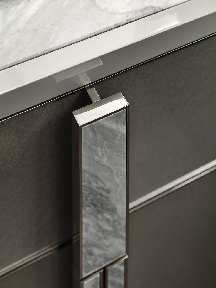 Marble handle with polished nickel frame