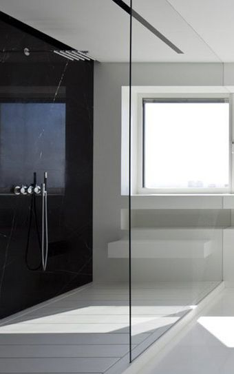 Black and white bathroom with a large glass divider, apartment in Manhattan  by Pitsou Kedem architects _