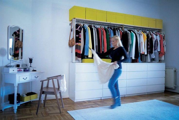 Closet organization idea - raise the clothing rail to put chests underneath