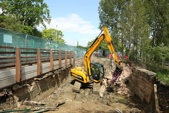 The north east causeway retaining wall being demolished using a pneumatic drill on the end of the digger arm. View looking north towards the Dunsford Park gatehouse. (May 14, 2016.) (Photo: Julian Morgan)  See more at our website: www.weyandarun.co.uk