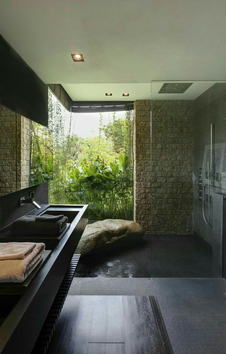 modern grotto, sunken shower, boulder bench, floor to ceiling garden windows, floating sink counter, cool moody natural elements, stone wall, dark stained wood,...