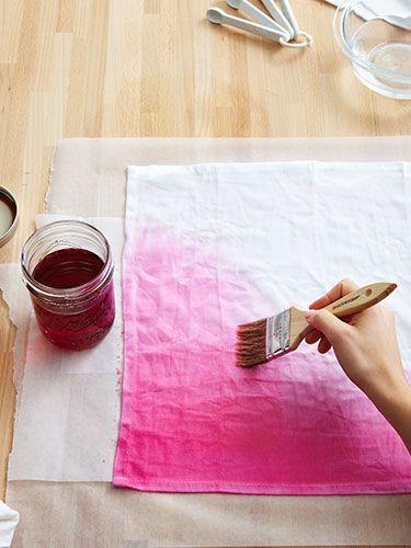make ombre napkins by painting fabric dye onto plain cotton napkins