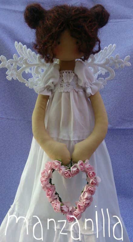 melina.....(a beautiful angel...upclose.  I also love her heart of roses that she holds.)....