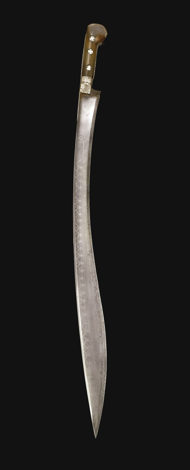 A RARE OTTOMAN HORN-HILTED SWORD (YATAGHAN), TURKEY, DATED 1181 AH/1767 AD the finely watered steel curved blade with a flat back edge and inscriptions along both sides of the blade enclosed in star motifs which continue to decorate the top ridge of the blade, the hilt with horn grips and silver studs, decorated with arabesques on the tang, applied silver floral decoration at the forte