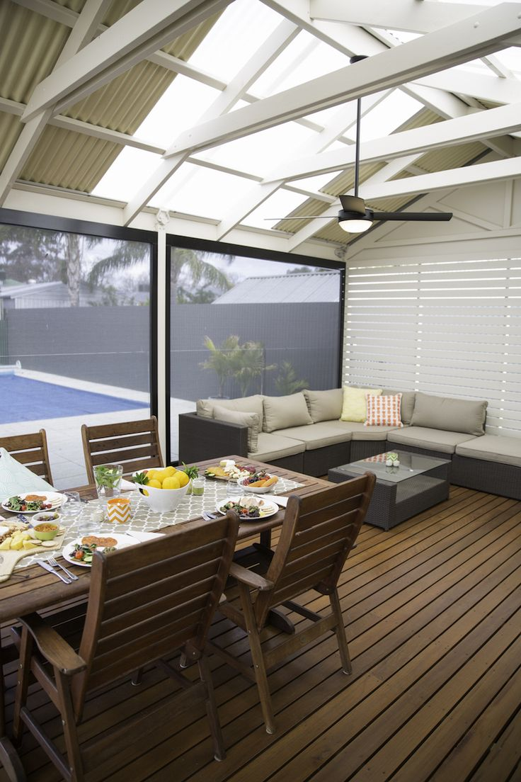 Beautiful pergola with timber decking and motion blinds by Australian Outdoor Living