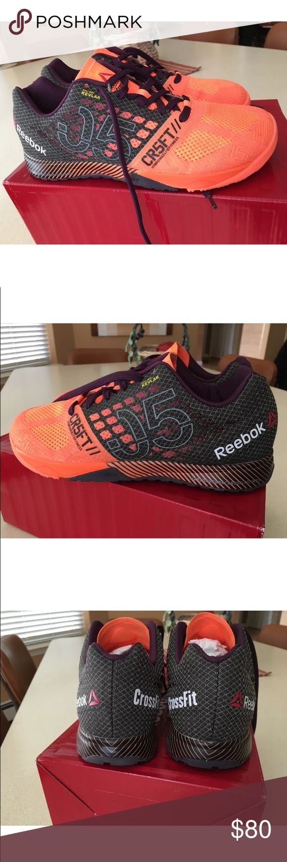 Reebok Crossfit Nano 5.0 Sneakers Bright orange sneakers with dark purple, dark gray and black accents! These shoes are light, comfortable and great for weight lifting or crossfit. They come with two sets of laces, one orange and one dark purple. Sold with both laces and box. New condition! Reebok Shoes Sneakers