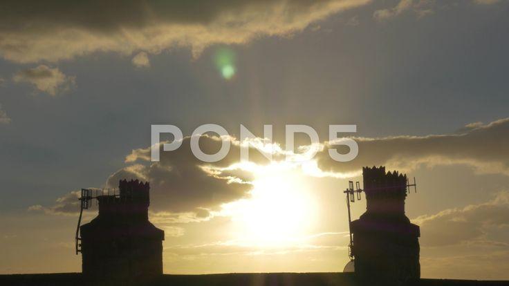 4k Sunset Birds Flying Chimney Rooftop Silhouette Dusk Clouds Lens Flare - Stock Footage   by RyanJonesFilms