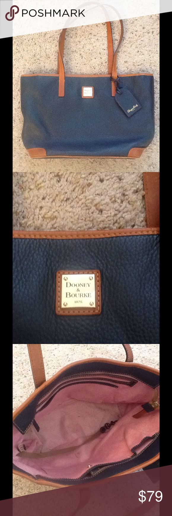 DOONEY & BOURKE NAVY BROWN LEATHER TOTE BAG PURSE DOONEY & BOURKE navy and brown leather Large Tote bag purse.  Excellent condition.  A tad of inner wear, shown.  Great gift!  I'd ship for Free!  Check out my other designer items Dooney & Bourke Bags Totes