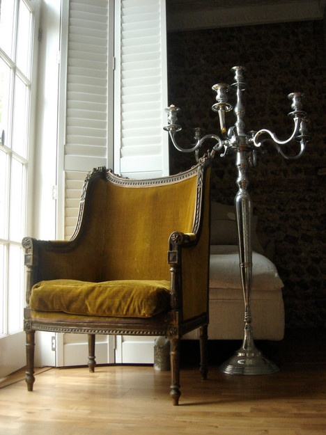 great mustard yellow chair and stunning against the black wall