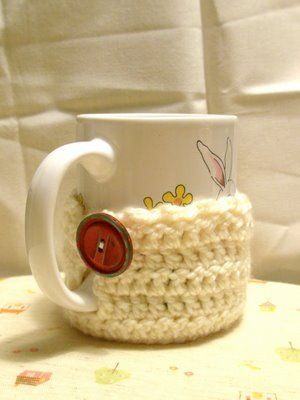 This is a precious original crochet pattern from Oh the Cuteness! that allows you to drink a hot cup of tea without scalding your hands. I have made several and plan to make more to give to all my fellow tea drinkers :)