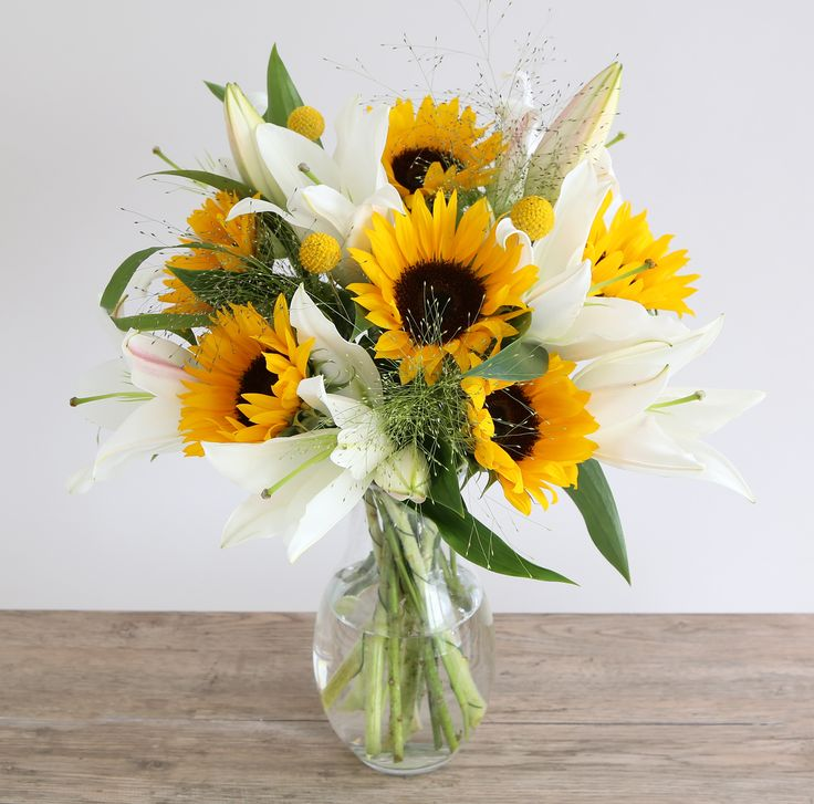 Sunflower & Lillies Bouquet: • 6 Sunflower • 3 White oriental lily  • 3 Panicum • 3 Craspedia
