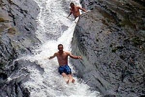 Natural water slide in a waterfall puerto rico