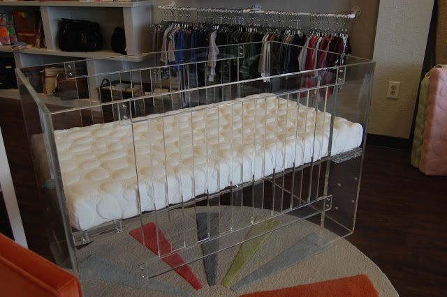 This is the trendiest crib I have ever seen... I mean, Beyonce has this! Completely lucite and even more beautiful in real life.  The crib is made by Nursery Works.  The mattress pad is equally as fun (Kourtney Kardashian has this one!) and is by a company called Nook.