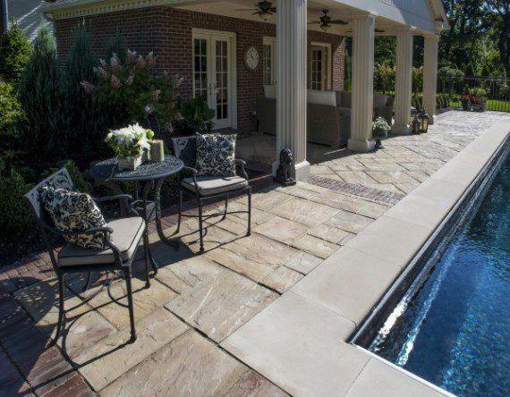 Unilock paver pool deck with Rivenstone