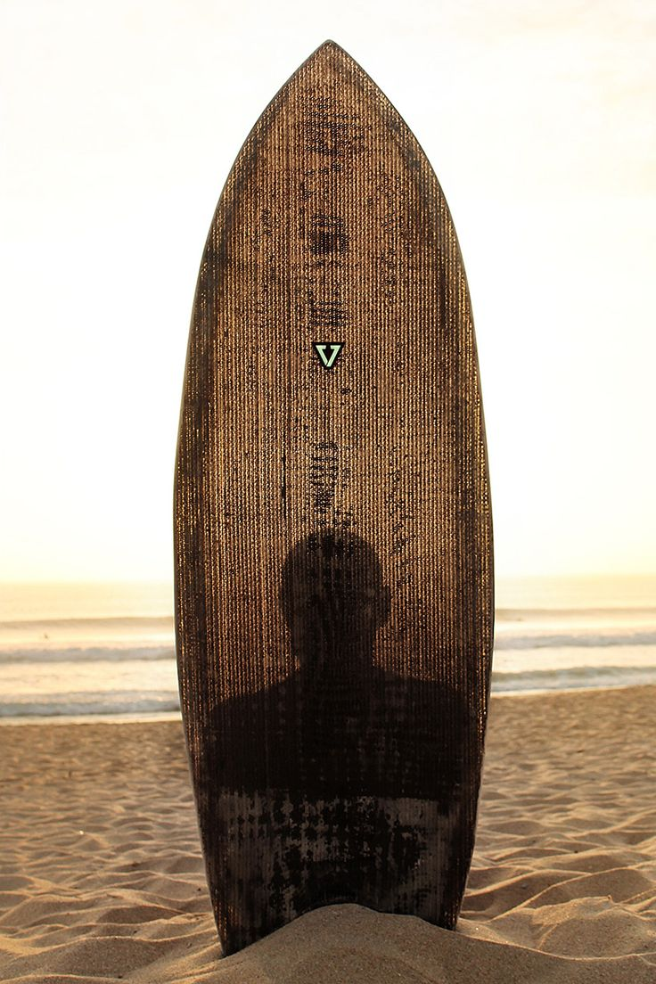 'Upcycled Surfboard', François Jaubert  Design.  90% of the board is made from reused materials the main structure (blank) is made up of recycled card boards,