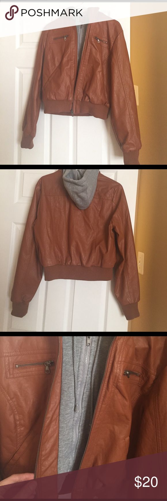 """Hooded leather jacket Adorable """"leather"""" jacket with hood. It has a double zipper detail for a layered look, both zippers fully operational. Says it's an XL but runs big as I wear a medium and could also fit a smaller Large if that makes sense! Perfect condition, only tried on. Just not a fan of the color on me ): Deb Jackets & Coats Utility Jackets"""