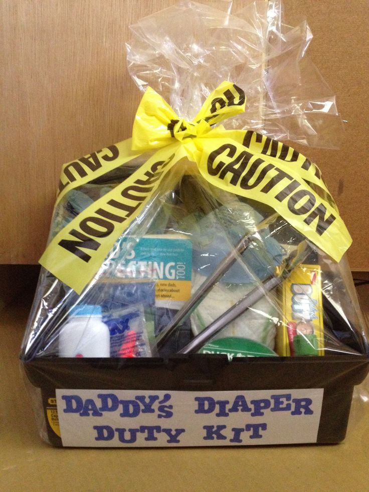 Daddy's Diaper Duty Kit... Toolbox filled with rubber gloves, face mask, tongs, a poncho, diaper, wipes, ear plugs, butt paste, baby lotion, baby powder, aspirin, duck tape, hand sanitizer, and daddy book tied up with caution tape of course