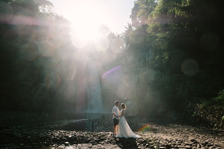 Ersoy & Oguz: Tegenungan Waterfall Bali Honeymoon Shoot. Romantic Tegenungan waterfall Bali honeymoon shoot for this gorgeous Turkish couple, Caglar and Oguz who planned their romantic honeymoon in Bali. As a nice wedding present for themselves, they decided to do a post wedding photoshoot in Tegenungan waterfall wearing the brides wedding gown. #bali #honeymoon #photography #waterfall #ubud