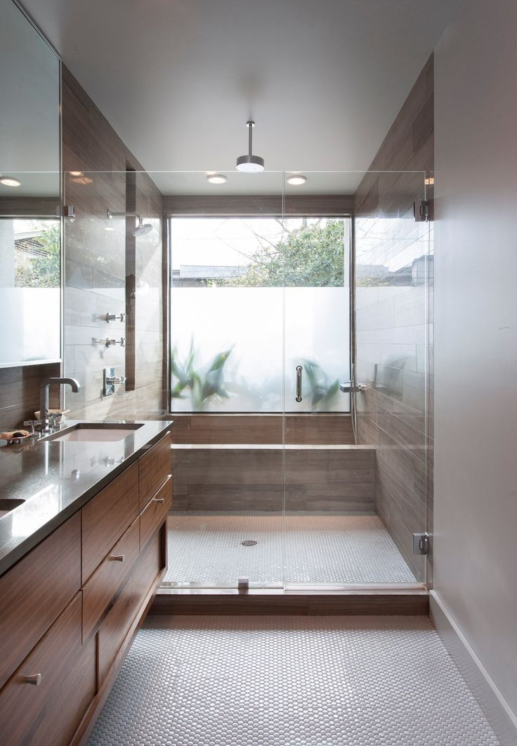2013 bath room winner, features a neat twist on the oversized shower/wet room idea: Here, the bathtub is actually inside the shower.