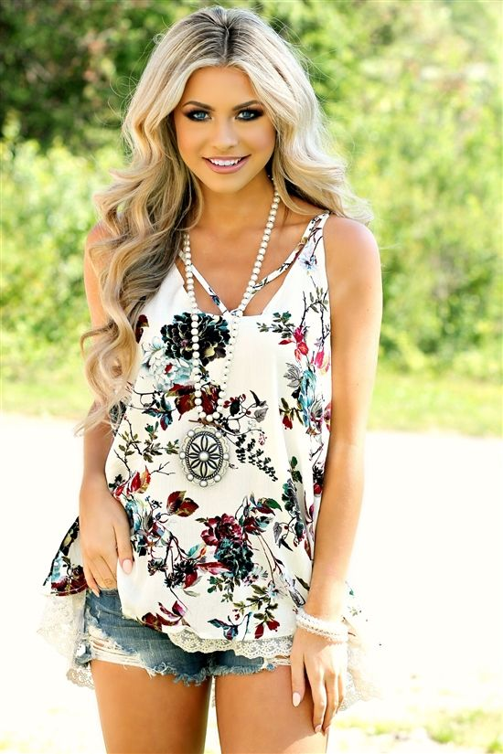 Our Finding Paradise Top is picture perfect! It's a sleeveless tunic top with floral print. #southernfriedchics