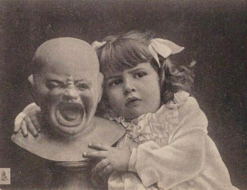 Creepy vintage postcard girl with ugly crying doll  --- Bah hahahahaha!! Love this description.