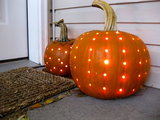 use a drill to make a polka-dotted carved pumpkin